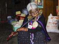 Chin State Woman playing the traditional nose flute